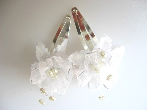 White hair flower clips with silver trim
